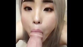 youthfull asian wife sucks on a fat white cock