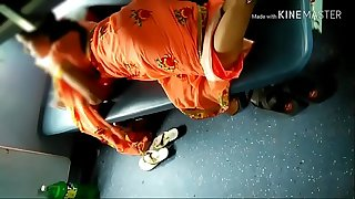 Desi handsome Indian Aunty showing her handsome legs from saree in teach